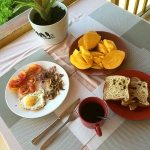 Fried Egg with vegetables, toast & coffee and fresh mango